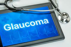 Tablet with the diagnosis Glaucoma on the display - stock photo