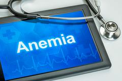 Tablet with the diagnosis Anemia on the display Stock Photos