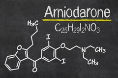 Blackboard with the chemical formula of Amiodarone - stock photo