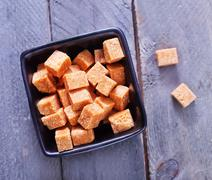 Stock Photo of reed sugar cubes in bowl