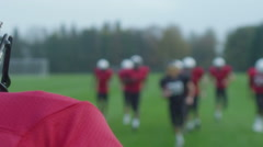 American football players at team practice - stock footage