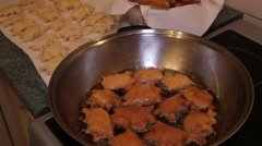 Homemade pierogies are fried on a frying pan - closer view Stock Footage