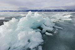 frozen baikal lake in winter - stock photo