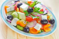 healthy greek salad in plate - stock photo
