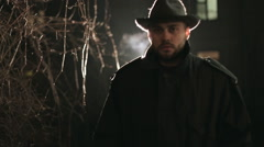 Portrait of terrible maniac at night in hat and coat Stock Footage