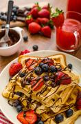 Belgian waffles with blueberries, strawberries - stock photo
