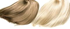 Picture presetning two straight, dense wigs - stock photo