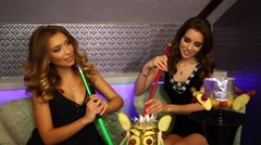 Beauty portrait of young two sexy women resting in the hookah room  Stock Footage