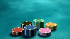 Stock Illustration of casino chips low angle blue table