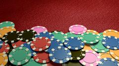 Stock Illustration of casino chips show hand red table