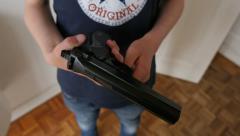 Boy holding gun Stock Footage