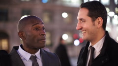 2 Smart cheerful businessmen chatting on a London city street in the evening Stock Footage