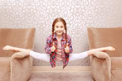 Little flexible girl splitting legs apart Stock Photos