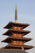 Pagoda in Osaka during sunset in Shitennoji temple in Japan - stock photo