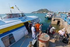 passengers in Vungtau get off hydrofoil from Saigon - stock photo