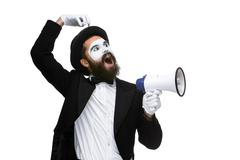 Man with a face mime screaming into megaphone Stock Photos