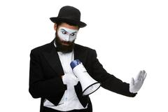 Man with a face mime screaming into megaphone - stock photo