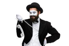 Man in the image mime holding a handset Stock Photos