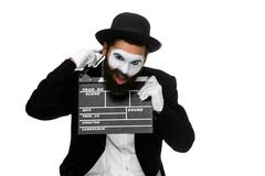 man in the image mime with movie board - stock photo