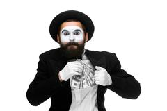Mime as businessman putting money in his pocket Stock Photos