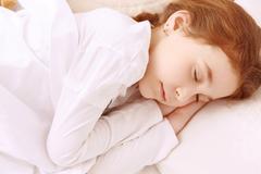 Pretty little girl sleeping well Stock Photos