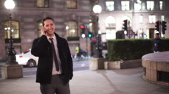 Smart cheerful businessman having a phone conversation on a London city street Stock Footage