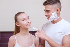 Lovely pair doing morning routine Stock Photos