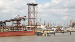 Oil refinery smoke stacks along the Mississippi river, Louisiana, USA Stock Footage