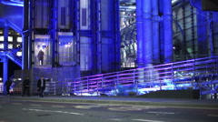 Exterior view of iconic London building, Lloyds of London, lit up at night Stock Footage