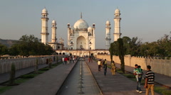 View on the fronts of Taj Mahal, with tourists walking in front. Stock Footage