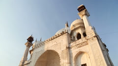 Entrance to Taj Mahal, with tourists passing by. Stock Footage