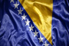 shining bosnia and herzegovina flag - stock photo