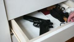 Grabbing gun from drawer Stock Footage