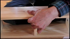 Close up of worker, wood drill and wooden stool construction Stock Footage
