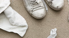 Messy Teenage Bedroom Floor With Dirty Shoes And Socks - stock footage