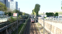 Morning traffic metro rer line and high-rise buildings in Paris Stock Footage