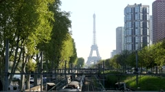 Eiffel Tower with metro rer line and high-rise buildings in Paris Stock Footage
