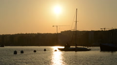 The timelaps of sunset and view on Sliema and sail yacht with Ukrainian flag Stock Footage