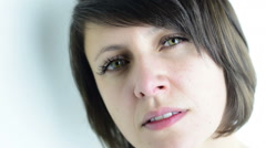 Close up beautiful green eyed adult woman in sad and pensive mood Stock Footage