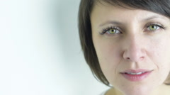 Close up of calm and grateful, attractive green eyed adult serene woman portrait Stock Footage