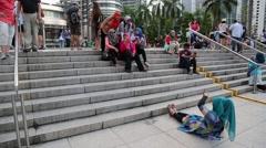 People relax of Petronas Towers in Kuala Lumpur Stock Footage