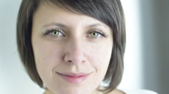 Close up of calm and grateful, attractive, green eyed adult woman smiling Stock Footage