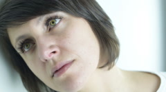 Close up beautiful green eyed adult woman in sad and pensive mood - stock footage