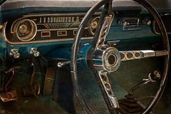 Old postcard with driver's cockpit of a vintage classic car - stock photo