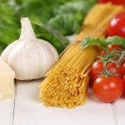 Italian cuisine ingredients for spaghetti pasta noodles meal with tomatoes - stock photo