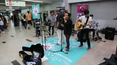 Street musicians play in the underpass in Kuala Lumpur Stock Footage
