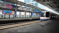 BTS or Skytrain stop receive people at Prathumwan Station in Bangkok Thailand Stock Footage