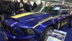 4k Ford Mustang at Motorshow tuning exhibition panning Stock Footage