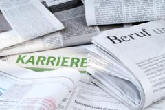 Job advertisements in the newspaper - stock photo