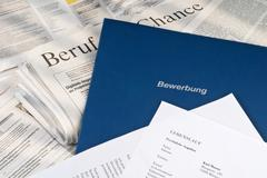 Application documents on daily newspaper Stock Photos